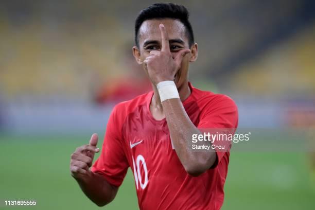 Muhammad Faris Ramli of Singapore celebrates after scoring their 1st goal during the Airmarine Cup match between Malaysia and Singapore at Bukit...