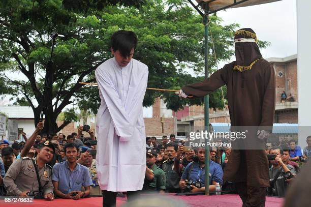 Muhammad Habibi Acehnese man for gay sex is being whipped in public for violating sharia law on May 23 2017 in Banda Aceh Indonesia A sharia court on...