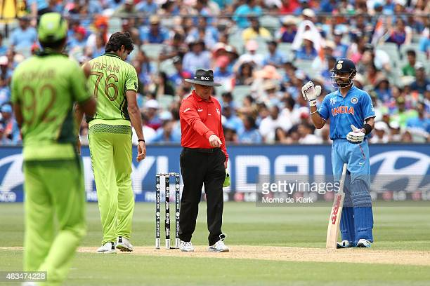 Muhammad Irfan of Pakistan gets a warning from umpire Ian Gould after running on the pitch while bowling during the 2015 ICC Cricket World Cup match...