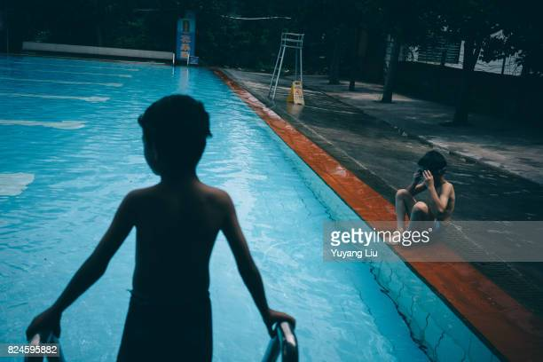 Muhammad is preparing his swimming glasses He can't swim and has fears of water Coach Abu takes the Uyghur kids to a swimming pool becasue the...