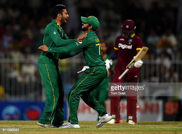 Muhammad Nawaz of Pakistan celebrates with Azhar Ali taking the wicket of Darren Bravo of West Indies during the first One Day International match...