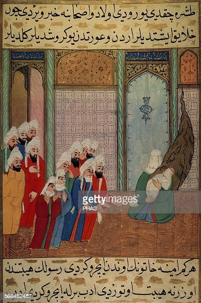 Muhammad newborn on his mother's arms shows to his grandfather Abd alMuttalib and other inhabitants of Mecca Miniature Topkapi Museum Istanbul Turkey