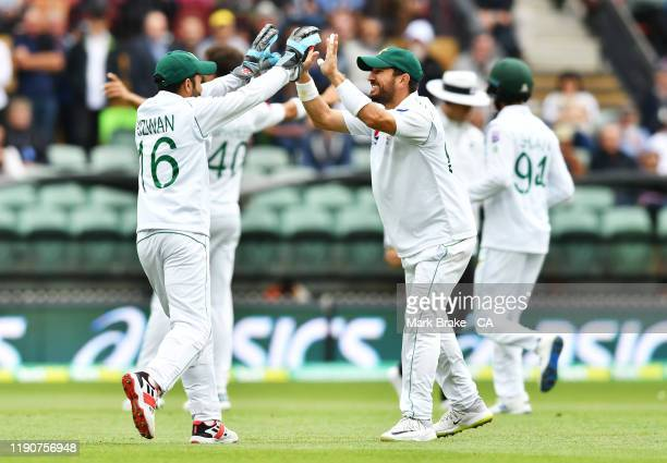 Muhammad Rizwan and Azhar Ali captain of Pakistan celebrates the wicket of Joe Burns of Australia during day one of the 2nd Domain Test between...
