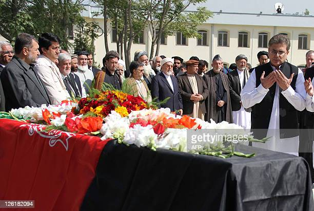 Muhammad Sadiq , Pakistani ambassador to Afghanistan, pays his respects at the coffin of slain Afghanistan High Peace Council and former president...