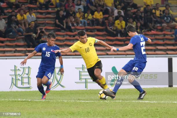 Muhammad Safawi Rasid of Malaysia and Jordan Jarvis of the Phillipines in action during the AFC U23 Championship qualifier between Malaysia and...