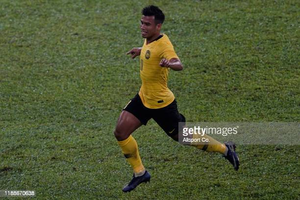 Muhammad Safawi Rasid of Malaysia celebrates after scoring their 1st goal against Indonesia during the 2022 Qatar FIFA World Cup Asian qualifier...
