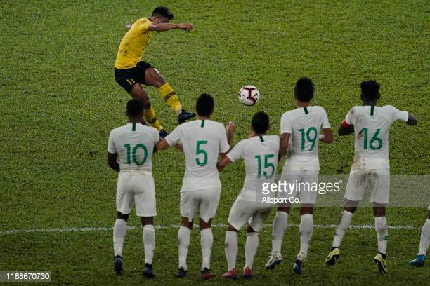 Muhammad Safawi Rasid of Malaysia scores from a free kick against Indonesia during the 2022 Qatar FIFA World Cup Asian qualifier group G match...