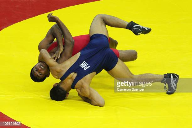 Muhammad Salman of Pakistan competes against Roshan Indi Liyanage of Sri Lanka during the men's 66kg freestyle qualifications at IG Sports Complex...
