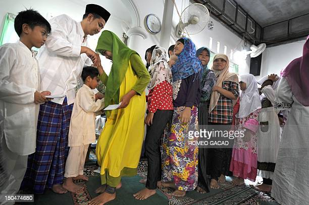 Muhammad Sanwani Na'im head of the Islamic boarding school locally known as Pesantren for local Indonesian orphans and children from poor families...