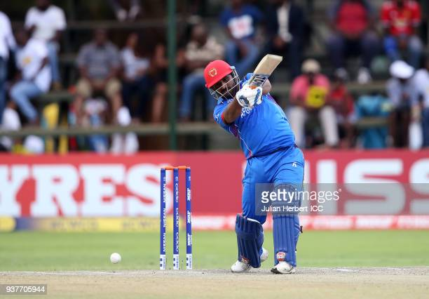 Muhammad Shahaz of Afghanistan scores runs during The ICC Cricket World Cup Qualifier Final between The West Indies and Afghanistan at The Harare...