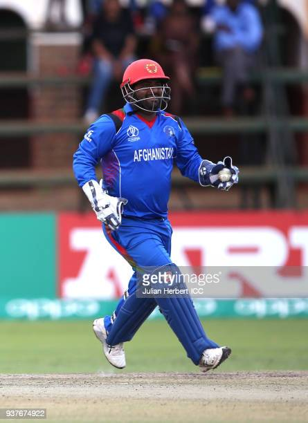 Muhammad Shahzad of Afghanistan celebrates the wicket of Shimron Hetmyer of The West Indies during The ICC Cricket World Cup Qualifier Final between...