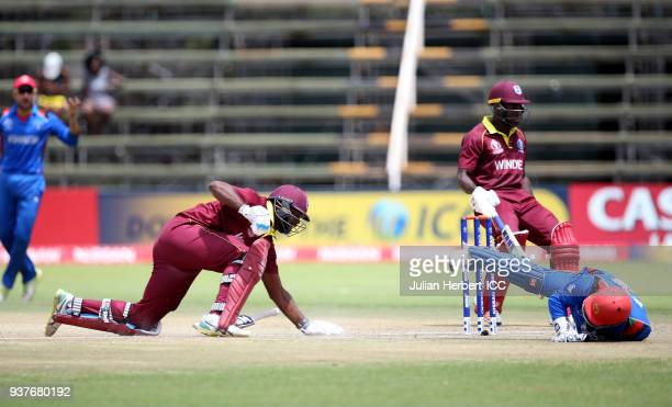 Muhammad Shahzad of Afghanistan fails to dimiss either Rovman Powell or Ashley Nurse of The West Indies during The ICC Cricket World Cup Qualifier...