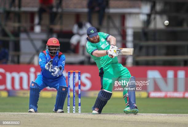 Muhammad Shahzad of Afghanistan looks on as Paul Stirling of Ireland scores runs during The ICC Cricket World Cup Qualifier between Ireland and...