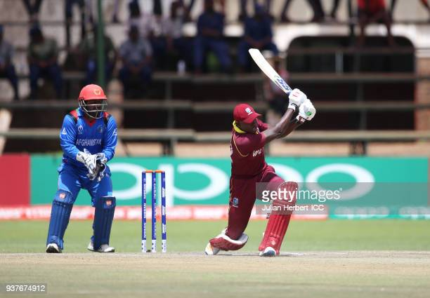 Muhammad Shahzad of Afghanistan looks on as Rovman Powell of The West Indies scores runs during The ICC Cricket World Cup Qualifier Final between The...