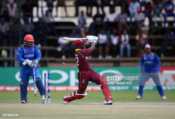 Muhammad Shahzad of Afghanistan looks on as Rovman Powell of The West Indies is dismissed during The ICC Cricket World Cup Qualifier Final between...