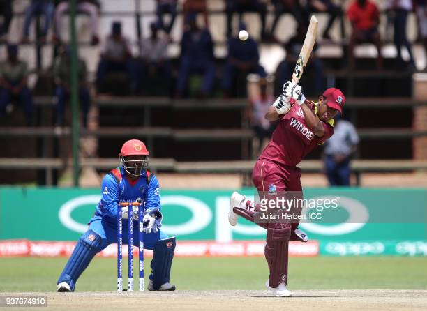 Muhammad Shahzad of Afghanistan looks on as Shimron Hetmyer of The West Indies scores runs during The ICC Cricket World Cup Qualifier Final between...