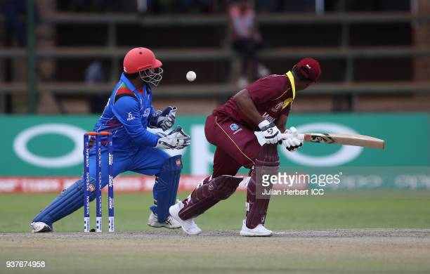 Muhammad Shahzad of Afghanistan takes the wicket of Shimron Hetmyer of The West Indies during The ICC Cricket World Cup Qualifier Final between The...