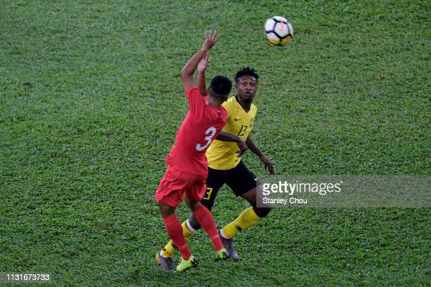 Muhammad Sumareh of Malaysia battles Muhammad Irwan of Singapore during the Airmarine Cup match between Malaysia and Singapore at Bukit Jalil...