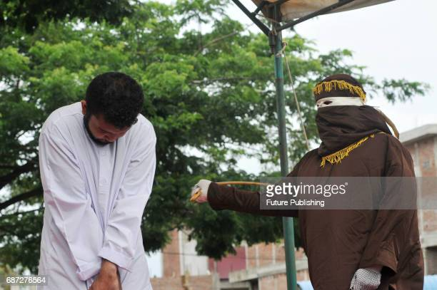 Muhammad Taufik Acehnese man for gay sex is being whipped in public for violating sharia law on May 23 2017 in Banda Aceh Indonesia A sharia court on...