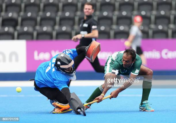 Muhammad Umar Bhutta of Pakistan scores his sides second goal past Zhiwei Ao of China during the 7th/8th place match between Pakistan and China on...