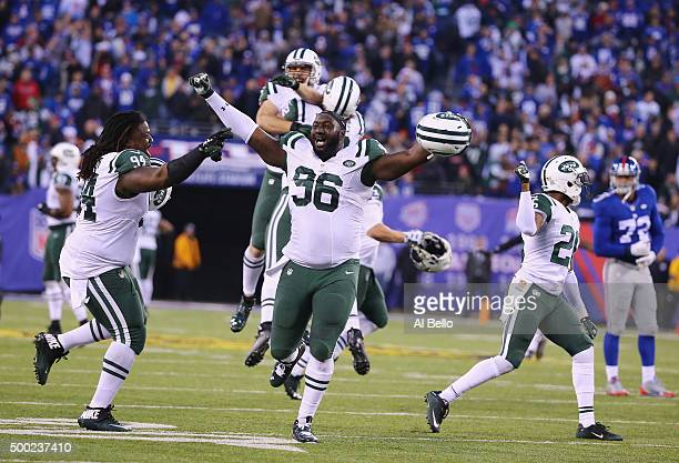 Muhammad Wilkerson and Damon Harrison of the New York Jets celebrate their 2320 overtime win against theNew York Giants during their game at MetLife...