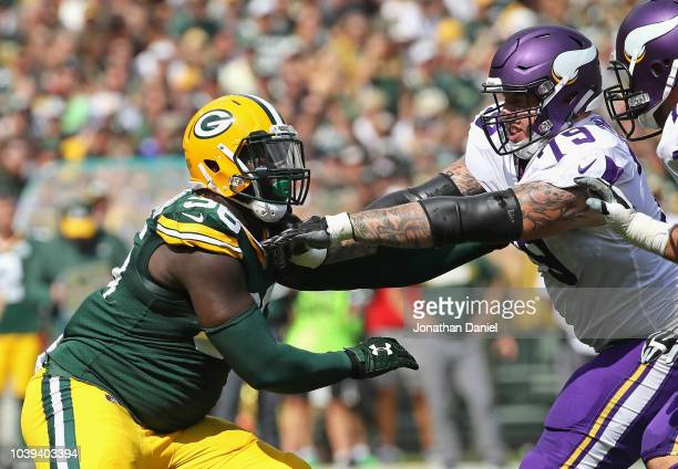 Muhammad Wilkerson of the Green Bay Packers rushes against Tom Compton of the Minnesota Vikings at Lambeau Field on September 16 2018 in Green Bay...
