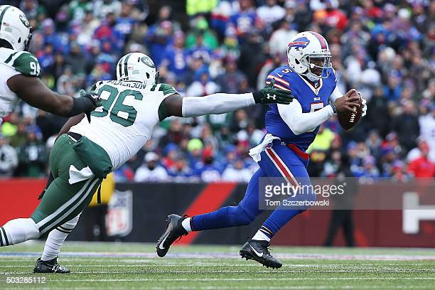 Muhammad Wilkerson of the New York Jets hurries Tyrod Taylor of the Buffalo Bills in the back field during the second half at Ralph Wilson Stadium on...