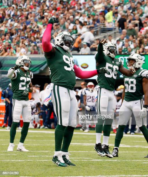 Muhammad Wilkerson of the New York Jets leads the defense in celebration after a big play in an NFL football game against the New England Patriots on...