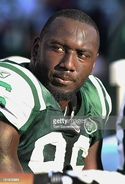 Muhammad Wilkerson of the New York Jets looks on from the sideline during NFL game action against the Buffalo Bills at Ralph Wilson Stadium on...