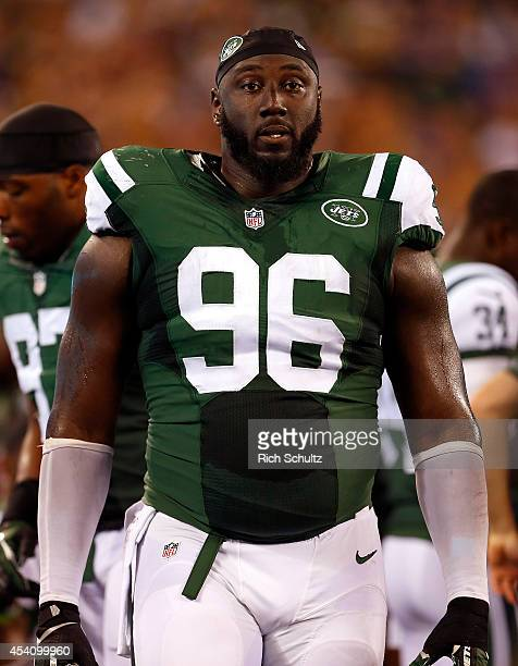 Muhammad Wilkerson of the New York Jets on the sidelines against the New York Giants in an NFL preseason game at MetLife Stadium on August 22 2014 in...