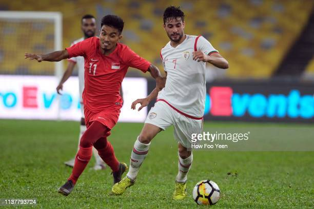Muhammad Yasir of Singapore nd Abdul Aziz Humaid during the Airmarine Cup final between Singapore and Oman at Bukit Jalil National Stadium on March...
