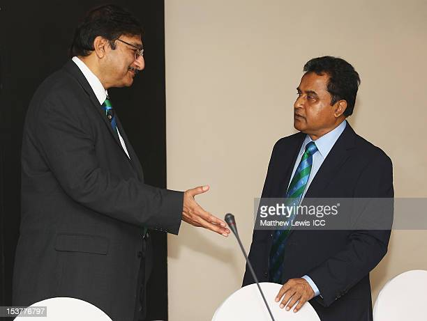 Muhammad Zaka Ashraf Chairman of the Pakistan Cricket Board talks to AHM Mustafa Kamal president of the Bangladesh Cricket Board during the ICC Board...