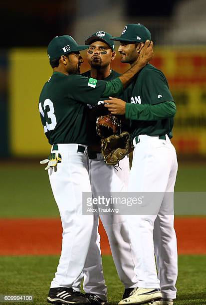 Muhammad Zohaib Faquir Hussain and Arshad Khan of Team Pakistan celebrate getting the last out of the first inning during Game 4 of the 2016 World...