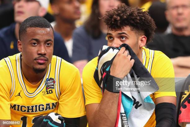 MuhammadAli AbdurRahkman and Isaiah Livers of the Michigan Wolverines look on from the bench in the first half against the Loyola Ramblers during the...