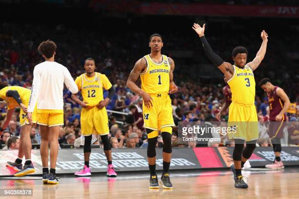 MuhammadAli AbdurRahkman Charles Matthews and Zavier Simpson of the Michigan Wolverines look on before the 2018 NCAA Men's Final Four Semifinal...