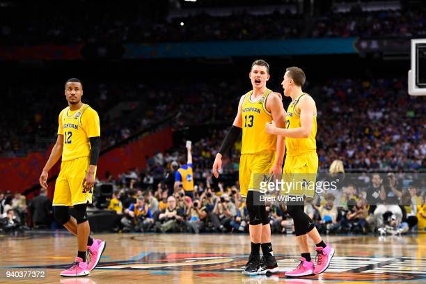 MuhammadAli AbdurRahkman Moritz Wagner and Duncan Robinson of the Michigan Wolverines react against the Loyola Ramblers in the 2018 NCAA Photos via...