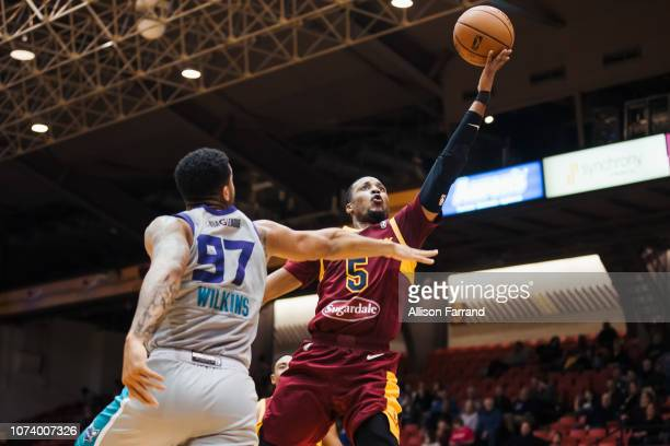 MuhammadAli AbdurRahkman of the Canton Charge makes a layup through coverage by Isaiah Wilkins of the Greensboro Swarm on December 15 2018 at the...