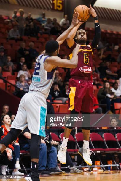 MuhammadAli AbdurRahkman of the Canton Charge shoots a 3pointer against Sam Thompson of the Greensboro Swarm on December 15 2018 at the Canton...