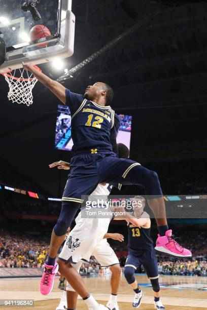 MuhammadAli AbdurRahkman of the Michigan Wolverines attempts a lay up against the Villanova Wildcats in the first half during the 2018 NCAA Men's...