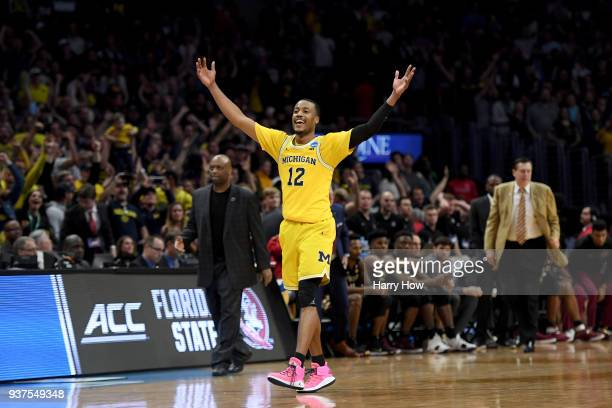 MuhammadAli AbdurRahkman of the Michigan Wolverines celebrates the Wolverines 5854 win against the Florida State Seminoles in the 2018 NCAA Men's...