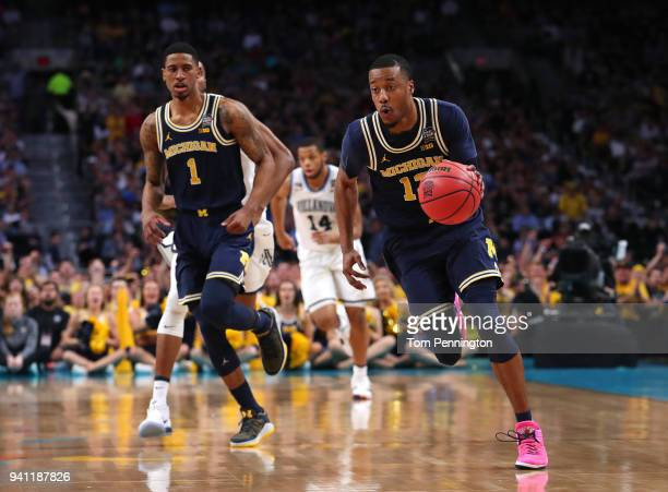 MuhammadAli AbdurRahkman of the Michigan Wolverines controls ball against the Villanova Wildcats in the first half during the 2018 NCAA Men's Final...
