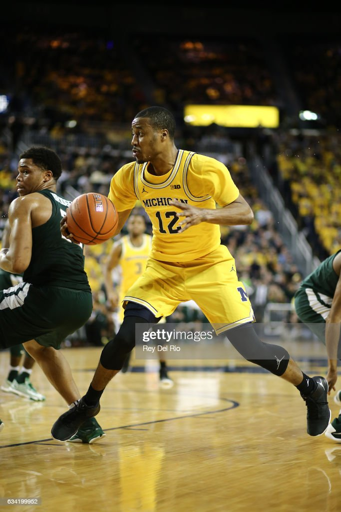 Muhammad-Ali Abdur-Rahkman #12 of the Michigan Wolverines drives to the basket against the Michigan State Spartans in the in the second half at Crisler Arena on February 7, 2017 in Ann Arbor, Michigan.