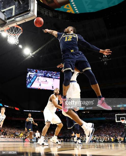 MuhammadAli AbdurRahkman of the Michigan Wolverines drives to the basket against Mikal Bridges of the Villanova Wildcats in the first half in the...