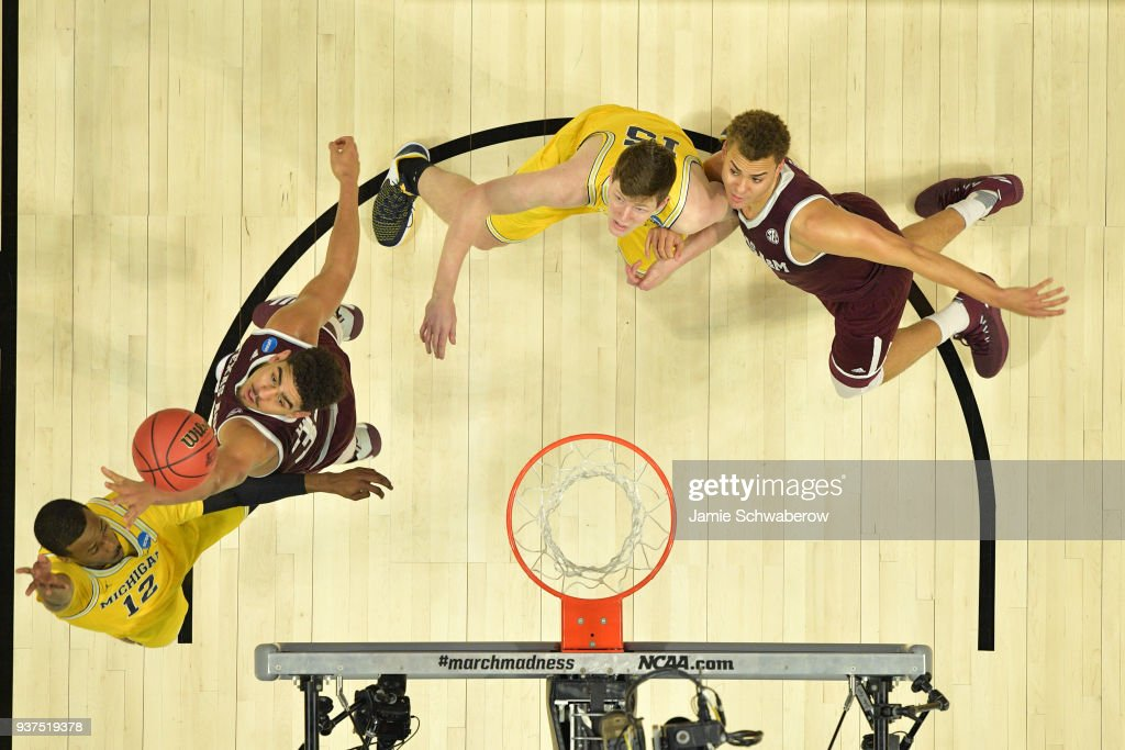 Muhammad-Ali Abdur-Rahkman #12 of the Michigan Wolverines goes up for the shot over Tyler Davis #34 of the Texas A&M Aggies during the third round of the 2018 NCAA Men's Basketball Tournament held at Staples Center on March 22, 2018 in Los Angeles, California.