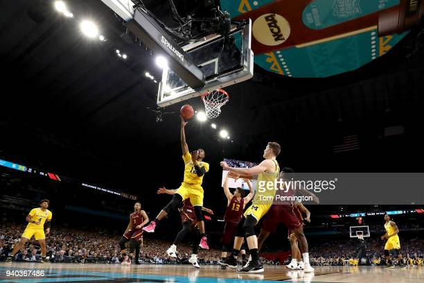 MuhammadAli AbdurRahkman of the Michigan Wolverines goes up with the ball in the first half against the Loyola Ramblers during the 2018 NCAA Men's...