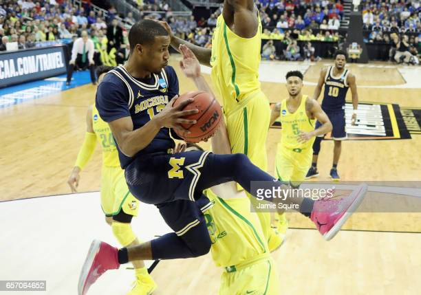 MuhammadAli AbdurRahkman of the Michigan Wolverines handles the ball in the second half against the Oregon Ducks during the 2017 NCAA Men's...