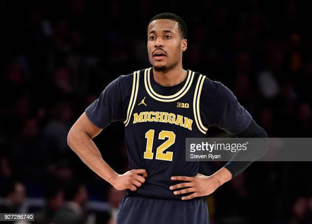 MuhammadAli AbdurRahkman of the Michigan Wolverines in action against the Michigan State Spartans during the semifinals of the Big Ten Basketball...