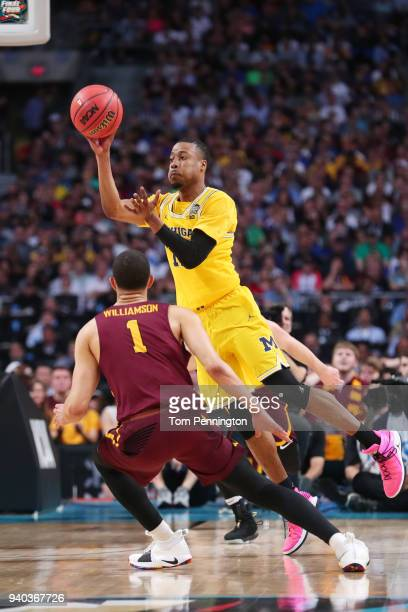 MuhammadAli AbdurRahkman of the Michigan Wolverines is defended by Lucas Williamson of the Loyola Ramblers in the second half during the 2018 NCAA...