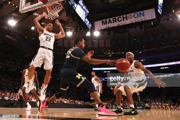 MuhammadAli AbdurRahkman of the Michigan Wolverines passes the ball against the Michigan State Spartans in the second half during semifinals of the...