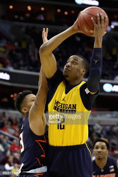 MuhammadAli AbdurRahkman of the Michigan Wolverines puts up a shot in front of Te'Jon Lucas of the Illinois Fighting Illini in the second half of the...